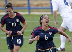 Natasha Kai races to celebrate her late winner against Iceland.