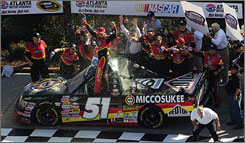 Kyle Busch and his crew celebrate their win at the American Commercial Lines 200 trucks race in Atlanta on Saturday afternoon.