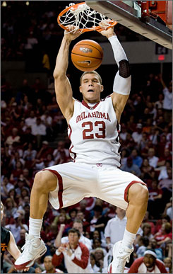 Oklahoma's Blake Griffin slams home two points during the fifth-ranked Sooners' slim victory over in-state rival Oklahoma State on Saturday.