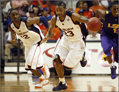 Quantez Robertson (23), DeWayne Reed and the Auburn Tigers have eight of their last nine and hope to make a splash in the SEC  and maybe even the NCAA  tournament.