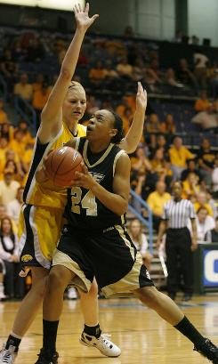 Emma Cannon, right, and UCF began the C-USA Tournament as the fifth-seed, but with their 65-54 overtime victory in the championship against Southern Mississippi, the young Knights earned an automatic berth to the NCAA tournament.