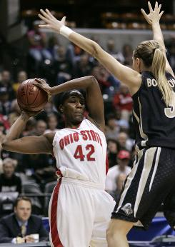 Ohio State center Jantel Lavender, the conference player of the year, faces pressure from Purdue's Natasha Bogdanova. Lavender led the Buckeyes with 25 points and 13 rebounds.