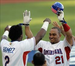 The Dominican Republic's Miguel Olivo, center, is congratulated by teammates Hanley Ramirez, left, after hitting a two-run home run in the fourth inning of their World Baseball Classic victory against Panama in San Juan, Puerto Rico on Sunday.