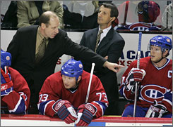Bob Gainey, left, the general manager of the Montreal Canadiens, fired coach Guy Carbonneau, right, and will head back to the bench to direct the team this season.