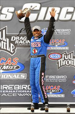 NHRA top fuel driver Antron Brown, celebrating after winning the Lucas Slick Mist Nationals at Firebird International Raceway last month in Arizona, leads in Top Fuel points.
