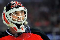 New Jersey Devils goaltender Martin Brodeur looks into the crowd during the first period against the Calgary Flames at the Prudential Center. After getting the victory, he is now staring down Patrick Roy's victory record.