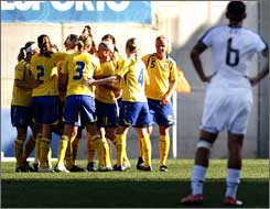 Sweden celebrates the opening goal of the Algarve Cup final.