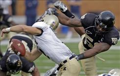 Wake Forest's Aaron Curry, right, shown hitting Navy quarterback Jarod Bryant last season, is expected to be a game-changer because of his ability to move blockers, tackle and defend passes.
