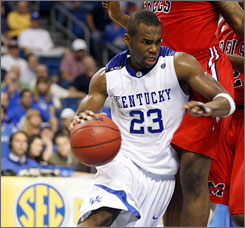 Jodie Meeks notched 25 points to help Kentucky scrap past Ole Miss and earn a showdown with LSU in the SEC quarterfinals.