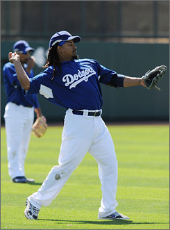 Dodgers manager Joe Torre decided to give    Manny Ramirez the day off to rest his left hamstring. Ramirez was scheduled to make his first spring training start.