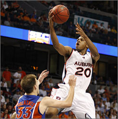 Auburn's Frankie Sullivan, going up for a shot against Florida's Nick Calathes during the second half, scored 12 points to lift the Tigers to a 61-58 win in the SEC quarterfinals.