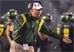 Oregon coach Mike Bellotti works the sidelines during last year's Holiday Bowl against Oklahoma State. The Ducks prevailed 42-31.