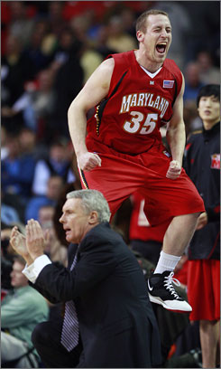 Maryland forward Dave Neal jumps in celebration as coach Gary Williams watches the last second of the Terrapins' 75-64 upset of Wake Forest.