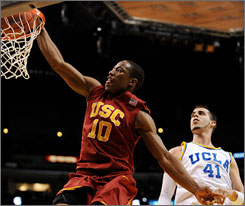 Southern Cal's DeMar DeRozan, dunking against UCLA in the Pac-10 semifinals, had 21 points and 13 rebounds to help the Trojans upset the 14th-ranked Bruins 65-55.