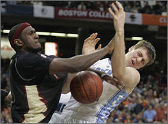 Florida State's Chris Singleton, left, collides with North Carolina forward Tyler Hansbrough as they fight for a rebound in the ACC semifinals. The Seminoles won 73-70 to reach the championship game for the first time.