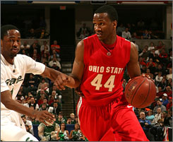 William Buford drives to the basket against the Michigan State defense during Ohio State's upset of the Spartans.
