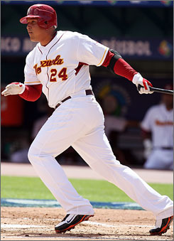 Venezuelan      Miguel Cabrera, who hit a home run in the fourth inning to give his team the lead against the Netherlands, hits into a fielders choice in his first at-bat.