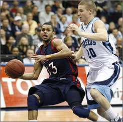Patrick Mills, left, and Saint Mary's won 26 games, but the Gaels were left out of the NCAA tournament field.
