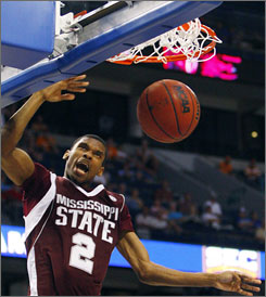 Mississippi State's Ravern Johnson slams home two points during the Bulldogs' upset of Tennessee in the SEC championship game in Tampa.