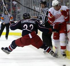 Blue Jackets defenseman Mike Commodore checks Red Wings right wing Marian Hossa, but it was Detroit that squashed Columbus, 4-0, on the Jackets' home ice.