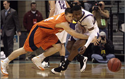 Texas-San Antonio's Joey Shank, left, and Stephen F. Austin's Josh Alexander collide while chasing down a loose ball during the Southland championship game. Stephen F. Austin won the game to claim their first-ever NCAA tournament bid.