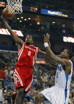 Rockets guard      Aaron Brooks goes in for a layup against Hornets guard      Rasual Butler during Houston's 95-84 road victory.