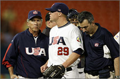 Davey Johnson had to take Florida relief pitcher Matt Lindstrom out of the game against the Netherlands on Sunday. Lindstrom is just one of a handful of players on the U.S. team dealing with injuries from the World Baseball Classic.