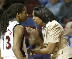 Temple coach Tonya Cardoza, right, and player Shaqwedia Wallace could have a date with No. 1 UConn if the ninth-seeded Owls win their first-round game vs. Florida. Cardoza spent 14 seasons as an assistant at UConn.