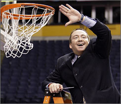 Morehead State coach Donnie Tyndall, preparing to cut down the net after his Eagles won the Ohio Valley conference tournament, says he embraces facing Alabama State in the play-in game.