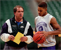 Phil Hopkins was coach of Western Carolina in 1996 when the Catamounts took Purdue to the wire. Joel Fleming, right, had a chance to win the game with a three-pointer in the closing seconds.