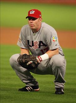 Team USA first baseman Adam Dunn reacts after fielding a ball and throwing it away attempting to make a play at the plate during Wednesday night's World Baseball Classic game at Dolphin Stadium in Miami. Venezuela beat Team USA 10-6, but both teams advance to the semifinals in Los Angeles.