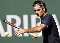 Roger Federer returns a shot against Fernando Gonzalez during their fourth-round match. Federer won 6-3, 5-7, 6-2 to run his career record against Gonzalez to 12-1.