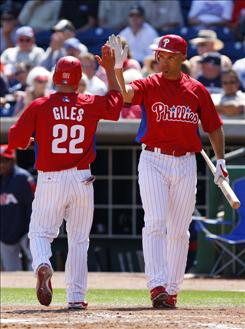 Philadelphia Phillies Raul Ibanez, right, getting a high-five from teammate Marcus Giles in a spring training game, averaged 107 RBI over the past four seasons with the Seattle Mariners.