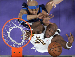 Lakers forward Lamar Odom, bottom, has stepped up his game since center Andrew Bynum went down with an injured knee.