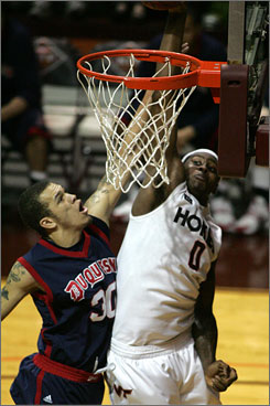 Virginia Tech's Jeff Allen, right, dunks the ball against Duquesne's Bill Clark during the first half. Allen scored 23 points as the Hokies held of Duquesne 116-108 in 2OT.