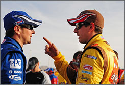 Kyle Busch (right) talks with brother Kurt Busch during qualifying for the March 1 race in Las Vegas. Kyle won the Shelby 427 at Las Vegas Motor Speedway, and Kurt was one of the first to congratulate him.