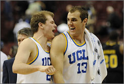 UCLA's Michael Roll, left, and James Keefe celebrate as the sixth-seeded Bruins escaped from No. 11 Virginia Commonwealth's upset bid in Philadelphia.