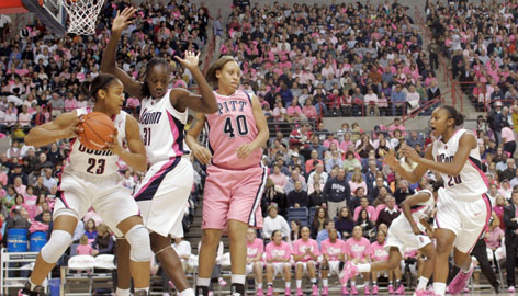Connecticut forward Maya Moore (23), center Tina Charles (31) and point guard Renee Montgomery (20) team up in a Feb. 15 victory over Pittsburgh. The Big Three led UConn to a 33-0 record at the top overall seed in the NCAA tournament.
