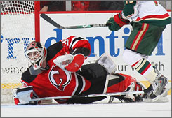 New Jersey goalie Martin Brodeur recorded his 101st shutout, two behind Terry Sawchuk's NHL mark, as the Devils whitewashed the Wild.