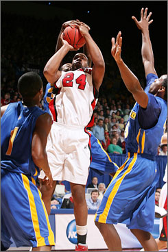 Samardo Samuels scored 15 points to help top-seeded Louisville dispatch 16th-seeded Morehead State in the Midwest Regional of the NCAA tournament.