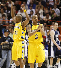 Marquette's Maurice Acker (2) and Jerel McNeal were able to breathe easier after avoiding the upset bid of Utah State.