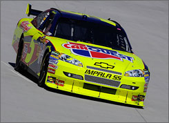 Mark Martin drives during qualifying for Sunday's Food City 500 at Birstol Motor Speedway. Martin, 50, qualified first and won his second consecutive pole.
