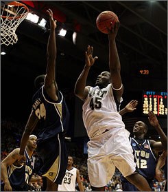 Pittsburgh's DeJuan Blair goes to the basket as East Tennessee State's Greg Hamlin tries to provide some defense.