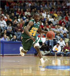 Siena guard Ronald Moore, dribbling up the court against Ohios State, hit two clutch three pointers  one to tie the game at the end of the first overtime, and the game-winner with 3.9 seconds remaining in the second OT.
