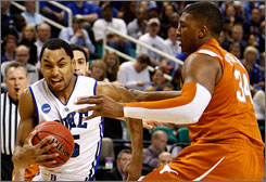 Gerald Henderson drives baseline on Texas' Dexter Pittman during the Blue Devils' 74-69 victory in Greensboro, N.C.