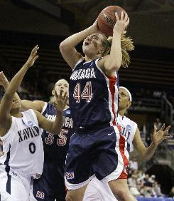 Gonzaga's Kelly Bowen grabs a rebound as the Bulldogs won the school's first women's NCAA tournament game by upsetting Xavier.