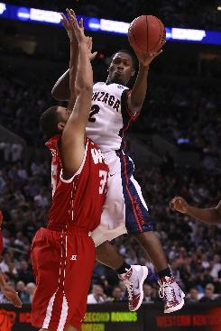 Jeremy Pargo, passing the ball around the arms of Western Kentucky's D.J. Magley during the second half, and Gonzaga advanced to the round of 16 for the fifth time in 11 years.