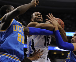 Villanova's Reggie Redding is fouled as he drives the lane during the third-seeded Wildcats' 89-69 romp over UCLA on Saturday in Philadelphia.