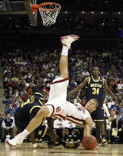 Oklahoma's Blake Griffin, falling over Michigan's Manny Harris during the first half, scored 33 points and grabbed 17 rebounds to lead the Sooners to the Sweet 16.