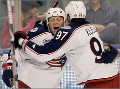 The Blue Jackets' Rostislav Klesta mobs Raffi Torres after Torres scored late in Columbus' comeback victory against the Florida Panthers.